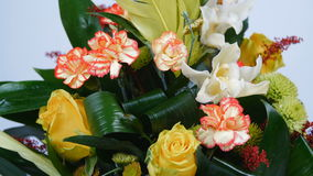Close-up. Flowers, bouquet, rotation on white background, floral composition consists of rose penny lane, carnation. Cymbidium orchid, solidago, Chrysanthemum stock video footage