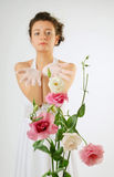 Close-up of flowers and a bride behind Royalty Free Stock Photo