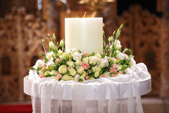 Close-up of flowers indoor. Close-up of flowers and a big candle on a greek wedding Stock Photography