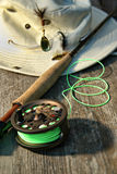 Close-up of fly-fishing reel and rod with hat Stock Image