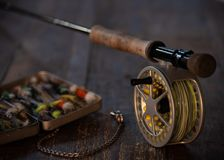 Close up fly rod and fly box stock photography