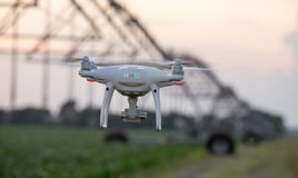 Drone flying in front of irrigation system in field Royalty Free Stock Images