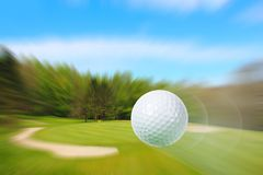Flying golf ball stock photo