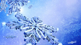 Close up flying snowflake on blue snow background. Royalty Free Stock Image