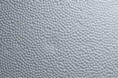 Close-up of foamed white plastic. Structure of white styrofoam plastic Royalty Free Stock Photography