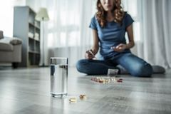 Young woman committing suicide by drugs royalty free stock photos