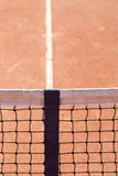Close up focus on tennis court net in the middle of pitch with c Stock Photos