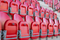 Close up of folded up seats in football stadium Stock Image