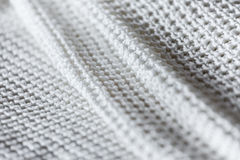 Close up of folded white knitwear stock photography