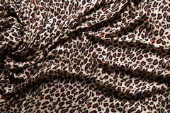 Close-up of a folds of stylish leopard scarf. Stock Image