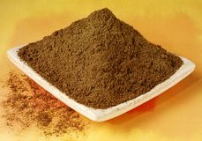 GARAM MASALA POWDER. Close up food ingredients on painted background in hand made dish royalty free stock images