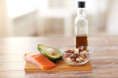 Close up of food and olive oil bottle on table Royalty Free Stock Image