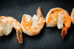 Close up food photo of fried shrimps on black slate background. Asian culture and cuisine. Food image of prawn for design of cafe,. Close up food photo of fried royalty free stock photo