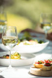 Close-up of food and wine glass on dining table Royalty Free Stock Photo