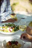 Close-up of food and wine glass on dining table Royalty Free Stock Photography