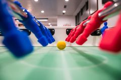 Close up of foosball Table Soccer Game. Match figures. Football Kicker Game with blue and red figurines Royalty Free Stock Image