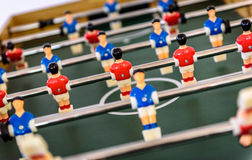Close up of foosball Table Soccer Game match figures. Royalty Free Stock Photography