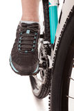 Close up foot of the cyclist pedalling bike Stock Images