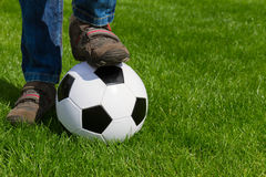 Close up of foot and football ball Royalty Free Stock Images