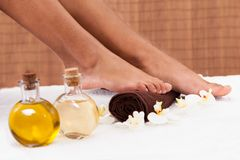 Close-up of foot getting spa treatment Stock Photos