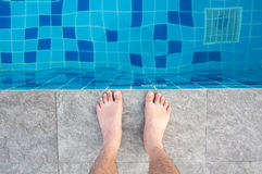 Close up foot of sport man standing beside swimming pool Royalty Free Stock Photo