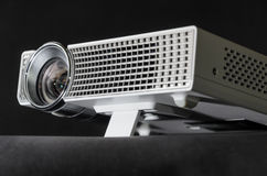 Close up on the foot of a white home cinema projector Royalty Free Stock Photo