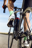 Close-up of the foot of a young man cycling. Royalty Free Stock Photo