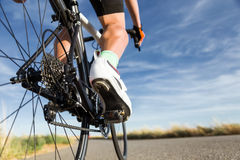 Close-up of the foot of a young man cycling. Royalty Free Stock Images