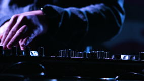 Close-up footage of a male DJs  hands mixing music at a party by using his control desk,artist is using his instrument. Close-up footage of a male DJs  hands stock video
