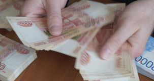 Male hands counting money. Russian money banknotes of 5,000 rubles stock footage