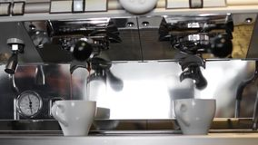 Close up footage of pouring coffee stream from professional machine in cup stock footage