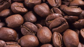 Close up footage of rotating roasted coffee beans Stock Photos