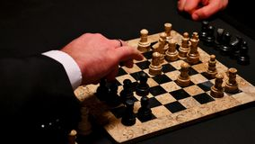 Close up footage of two players playing chess