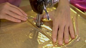 Woman working as fashion designer with sewing machine stock video footage