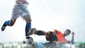 Close up of a football action scene with competing soccer players on white background. Two soccer players chase the ball at the stadium stock photos