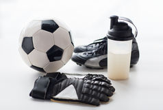 Close up of football boots, gloves and bottle Stock Photography