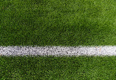 Close up of football field with line and grass Royalty Free Stock Photo