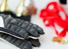 Close up of football, gloves, cups and medals Royalty Free Stock Photo