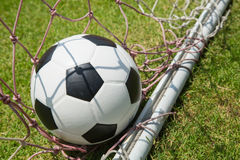 Close up football in the goal Royalty Free Stock Images