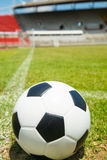 Close up football in the goal Royalty Free Stock Image