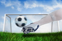 Close up of football player kicking ball Stock Image