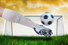 Close up of football player kicking ball Stock Photography