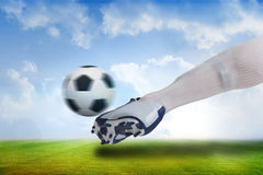 Close up of football player kicking ball Royalty Free Stock Image
