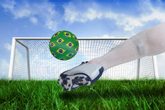 Close up of football player kicking brasil ball Stock Photo