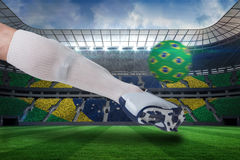 Close up of football player kicking brasil ball Royalty Free Stock Photos