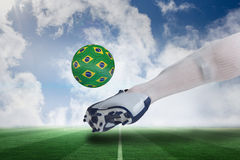 Close up of football player kicking brasil ball Stock Images