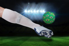 Close up of football player kicking brasil ball Stock Photography