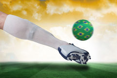 Close up of football player kicking brazil ball Royalty Free Stock Images