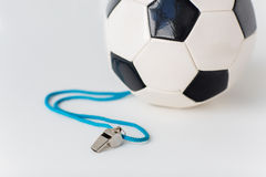 Close up of football or soccer ball and whistle Royalty Free Stock Photos
