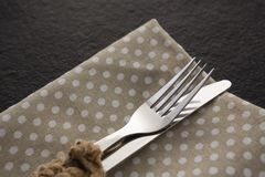 Fork and knife on a dotted napkin. Close-up of fork and knife on a dotted napkin Stock Photos